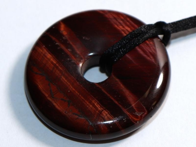 Red tigers eye on cord